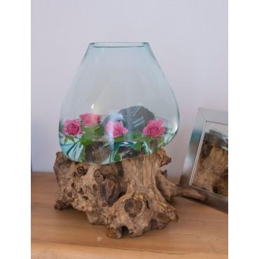 Cast glass vase on teak root