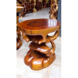 A round stool made of Suar wood
