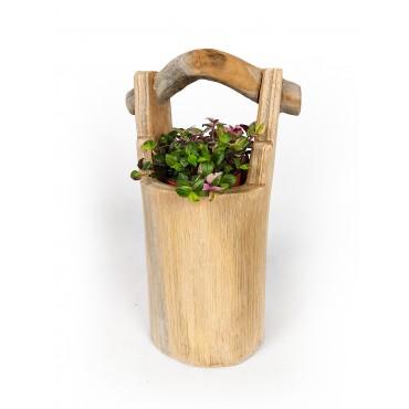 A hand-carved flower pot -...