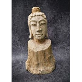 A hand-carved figure of the Buddha in teak wood