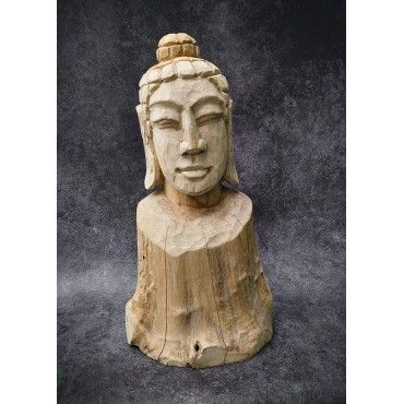 A hand-carved figure of the...