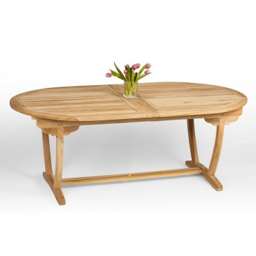 A large teak wood garden table with folding